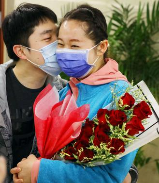 Nurse who delayed her nuptials to fight COVID-19 pandemic finally weds her faithful fiance.